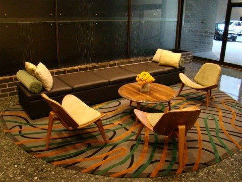 Furniture and waterfall in Lake Point Tower reception area